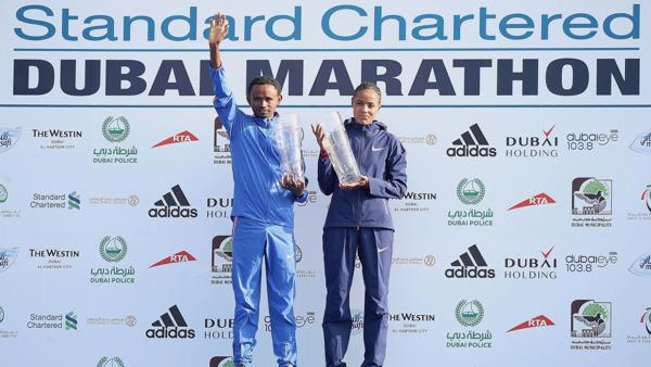 Ethiopia's Mosinet Geremew and Roza Dereje smash the course records and take the titles at the Standard Chartered Dubai Marathon, the world's richest marathon. (PRNewsfoto/Dubai Marathon)