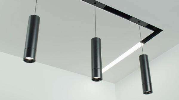 This shows the magnetic slot system with both pendant and linear lighting.