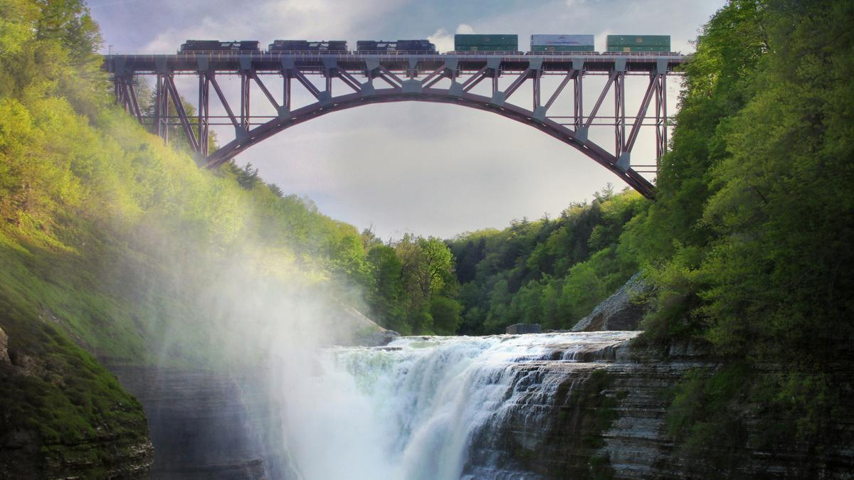 An eastbound Norfolk Southern intermodal train travels across the Genesee Arch Bridge, which spans the Genesee River Gorge in Letchworth State Park. Photo courtesy of John Kucko Digital.