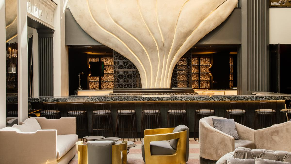 "The Mayfair Hotel's lobby lounge with M Bar and ""The Mayfair Flower"" sculpture taking center stage"