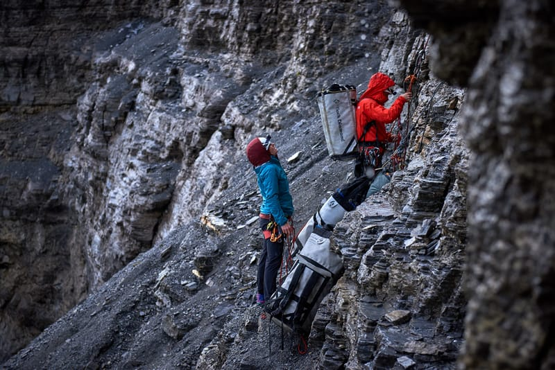 Jacopo Larcher and Babsi Zanger dealing with a lot of gear during a thunderstorm on Eiger Nordwand. I was there to document the first single-push repetition of the hardest route in the wall. ©Paolo Sartori